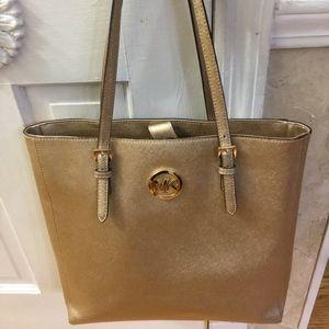 78594d287 Michael Kors. Gorgeous Gold Metallic Michael Kors Tote Handbag
